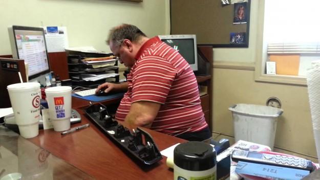 Fat Man At Office Desk